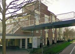 Plan voor woningen in kantoorpand aan de Graaf Karellaan 1-35